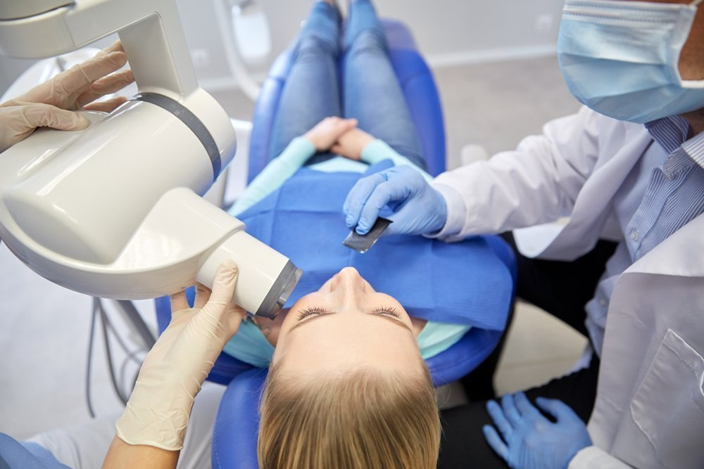 dentist and patient with dental x-ray machine - Idaho Falls orthodontist