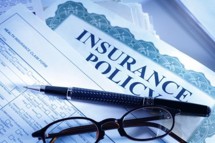insurance policy with pen and glasses over it